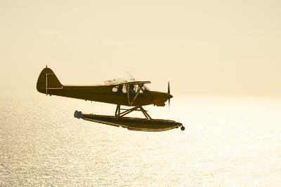 A PA18 Super Cub Floatplane Flying to Conception Island-Jad Davenport-Photographic Print