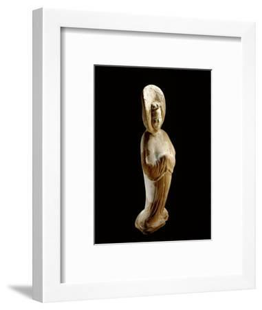 A painted earthenware figure of a lady wearing a voluminous hooded cloak-Werner Forman-Framed Giclee Print