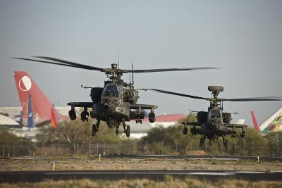 A Pair of Ah-64D Apache Longbow Helicopters Lift Off-Stocktrek Images-Photographic Print