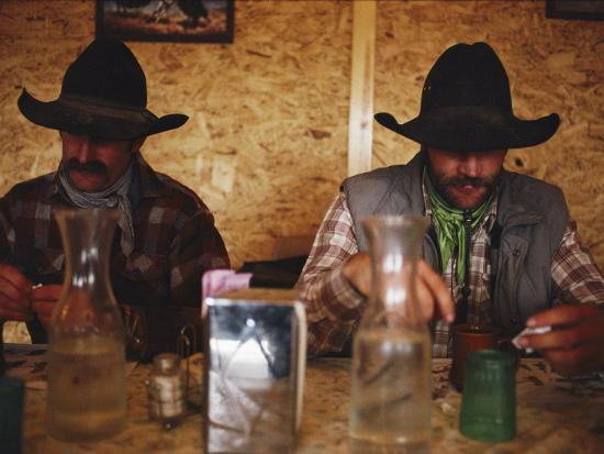 A Pair of Cowboys Enjoy a Cup of Coffee at a Local Restaurant--Photographic Print