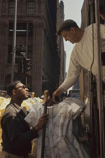 A Pair of Push Boys Unload Racks of Dresses on 7th Avenue, New York, New York, 1960-Walter Sanders-Photographic Print