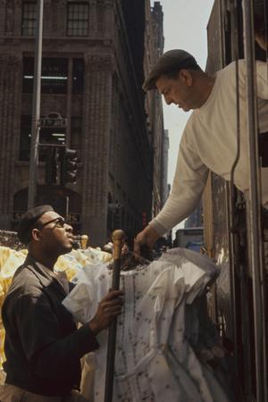 https://imgc.artprintimages.com/img/print/a-pair-of-push-boys-unload-racks-of-dresses-on-7th-avenue-new-york-new-york-1960_u-l-q1313ho0.jpg?p=0