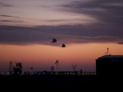 A Pair of UH-60 Black Hawk Helicopters Approach their Landing in Baghdad, Iraq--Photographic Print