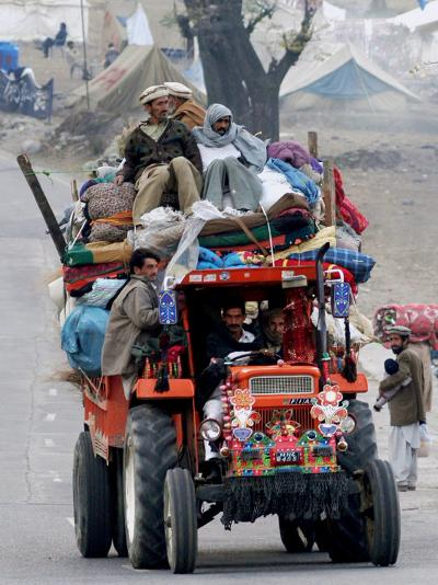 A Pakistan Earthquake Survivor Family Ride a Vehicle as They Make Their Way to Mansehra--Photographic Print