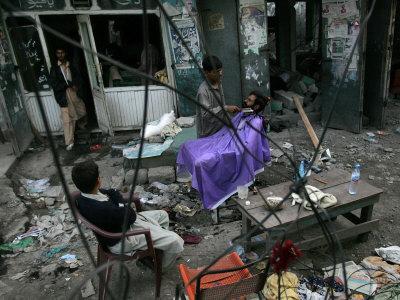 https://imgc.artprintimages.com/img/print/a-pakistani-barber-gives-a-haircut-and-beard-trim-to-a-customer_u-l-q10olqd0.jpg?p=0