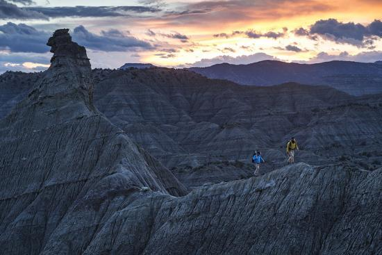 A Paleontologist and Volunteer Walk a Ridgeline in the Fossil Rich Badlands of Southern Utah-Cory Richards-Photographic Print