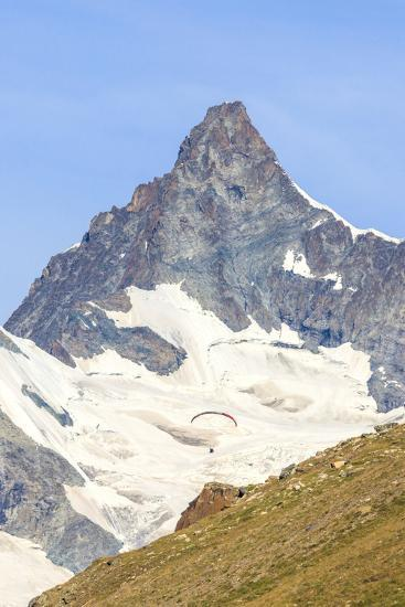A Paraglider Flies in Front of the Majestic Obergabelhorn, Pennine Alps, Swiss Alps-Roberto Moiola-Photographic Print