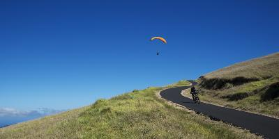A Paraglider Soars Above a Mountain Biker-Chad Copeland-Photographic Print