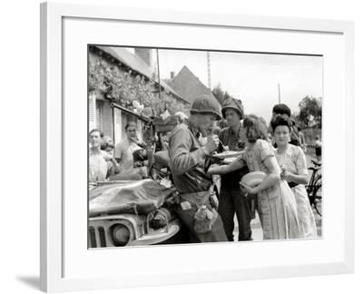 A Parked American Jeep Is Surrounded by Civilians in a Village--Framed Photographic Print
