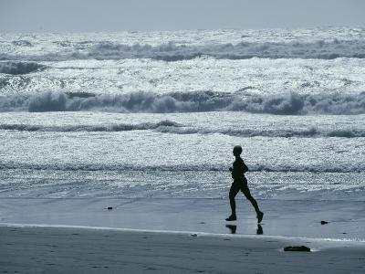 A Person Jogs Along the Beach-David Boyer-Photographic Print