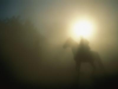 A Person on a Horse is Silhouetted in the Fog-Sisse Brimberg-Photographic Print