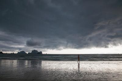 A Person Walking Along a Beach as an Afternoon Storm Approaches Railay Beach-Erika Skogg-Photographic Print