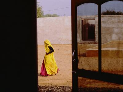 A Person Walking Past an Open Doorway-Michael S^ Lewis-Photographic Print