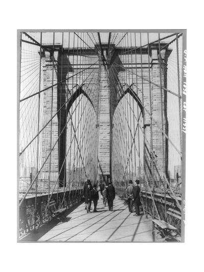 A Photograph of People Standing and Walking on the Brooklyn Bridge Promenade--Photographic Print