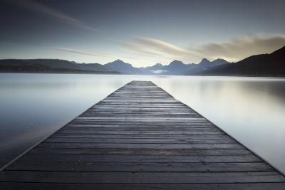 A Pier on the Edge of a Lake in Montana's Glacier National Park-Keith Ladzinski-Photographic Print