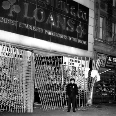 A Policeman Stands in Front of a Pawn Shop--Photographic Print