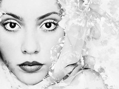 A Portrait of a Woman with White Floral Elements and Big Dark Eyes Looking into the Camera-Alaya Gadeh-Photographic Print