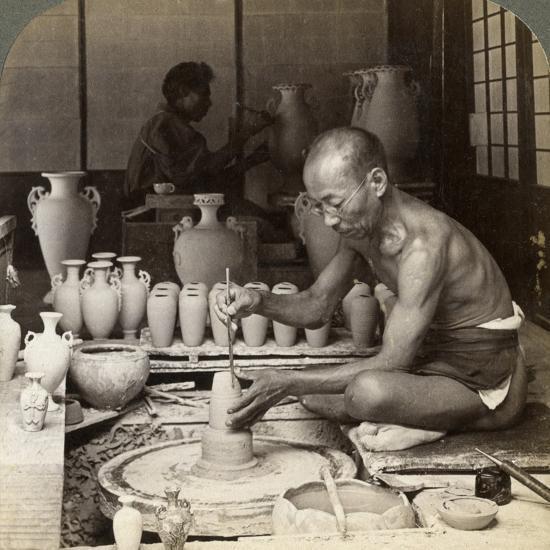 A Potter and His Wheel, Fashioning a Vase of Awata Porcelain, Kinkosan Works, Kyoto, Japan, 1904-Underwood & Underwood-Photographic Print
