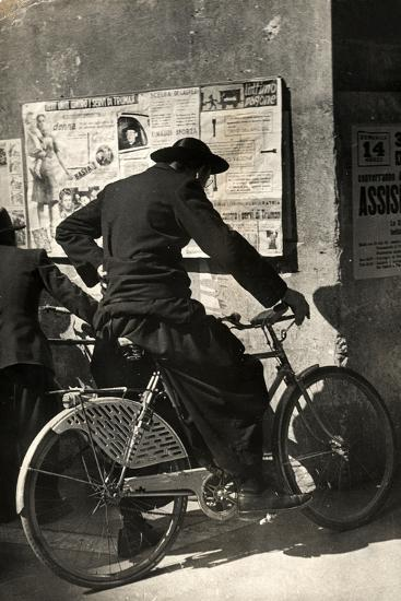 A Priest on a Bicycle Reading Wall Newspapers of the Popular Democratic Front-Luigi Leoni-Photographic Print