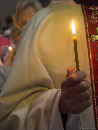 https://imgc.artprintimages.com/img/print/a-priest-s-hand-holding-a-candle-during-mass-in-easter-week-old-city-israel_u-l-p1lg860.jpg?p=0