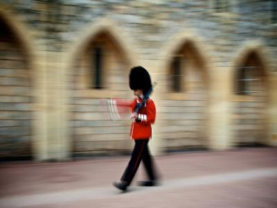 A Queen's Guard with a Rifle Walking Outside Windsor Castle-Heather Perry-Photographic Print