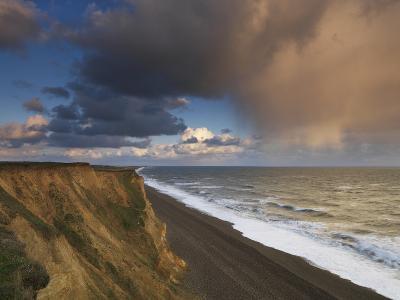 A Rain Cloud Approaches the Cliffs at Weybourne, Norfolk, England-Jon Gibbs-Photographic Print