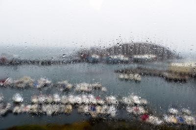 A Rain Storm Lashing a Window Overlooking a Fishing Boat Harbor-Jason Edwards-Photographic Print