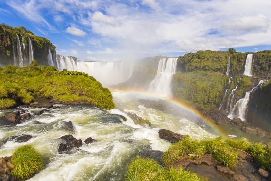 A Rainbow at Iguazu Waterfalls on the Border of Argentina and Brazil in South America-Mike Theiss-Photographic Print