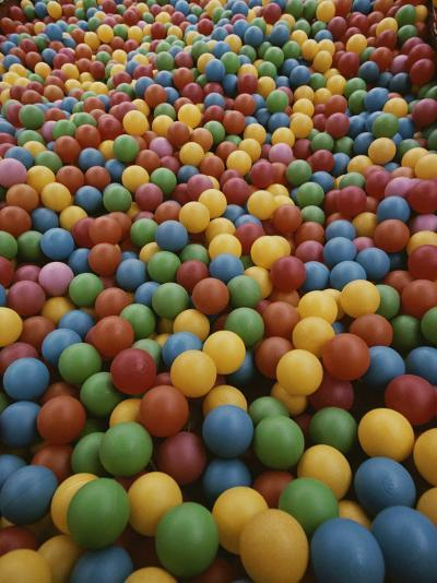 A Rainbow-Colored Landslide of Toy Balls in Abstract Patterns-Stephen St^ John-Photographic Print