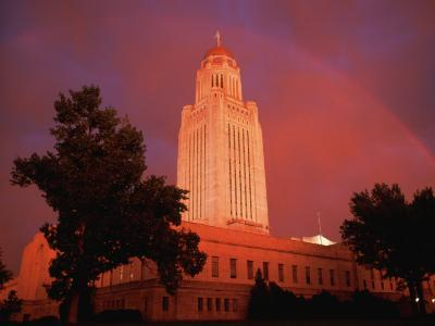A Rainbow Shines Over the Nebraska State Capitol after a Storm-Joel Sartore-Photographic Print