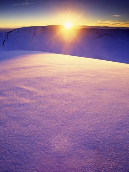 A Rarely Seen View of Snow-Covered Sand Dunes, at Sunset-Keith Ladzinski-Photographic Print