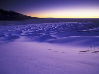 A Rarely Seen View of Snow-Covered Sand Dunes, at Twilight-Keith Ladzinski-Photographic Print