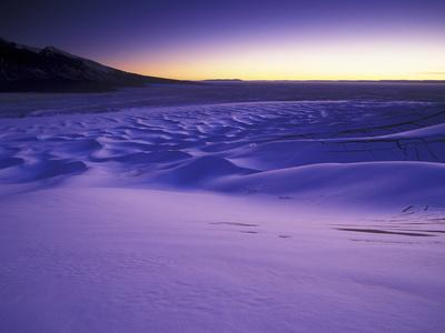 https://imgc.artprintimages.com/img/print/a-rarely-seen-view-of-snow-covered-sand-dunes-at-twilight_u-l-pu7bnq0.jpg?p=0