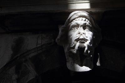 A Ray of Light Illuminating a Sculpture of a Man's Face-Joe Petersburger-Photographic Print