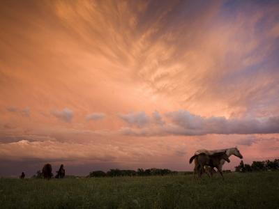 A receding thunderstorm creates a blazing sunset-Jim Richardson-Photographic Print
