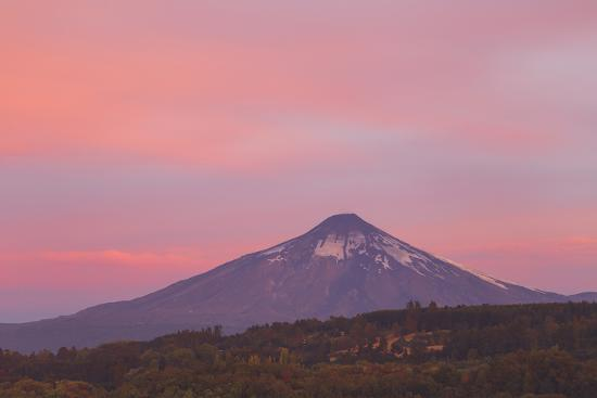 A Red and Pink Sky at Sunset Casting a Reddish Glow on Villarrica Volcano-Mike Theiss-Photographic Print