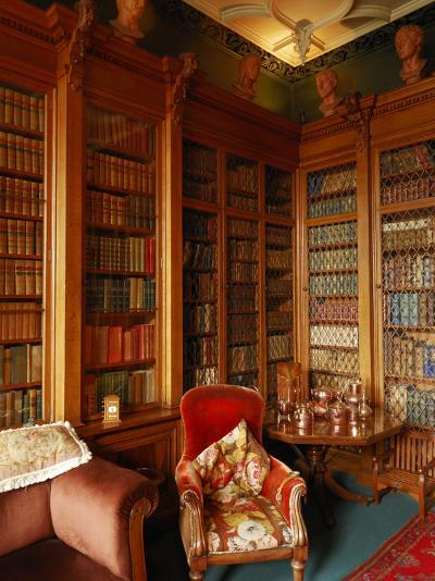 A Red Chair Sits Amid Shelves of Books in Balfour Castle's Library-Jim Richardson-Photographic Print