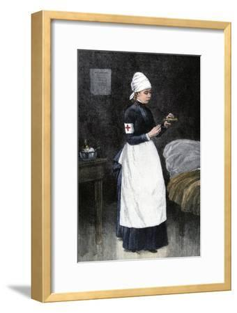 A Red Cross Hospital nurse Pouring Medicine, Late 1800s