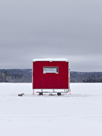 A Red Ice Fishing Shack Is Positioned on a Frozen Lake Wesserunsett Near East Madison, Maine-Hannele Lahti-Photographic Print