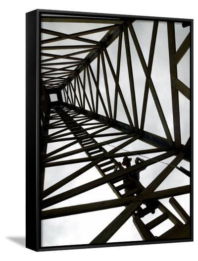 A Reenactor is Silhouetted Inside a Replica of the Spindletop Oil Derrick--Framed Canvas Print