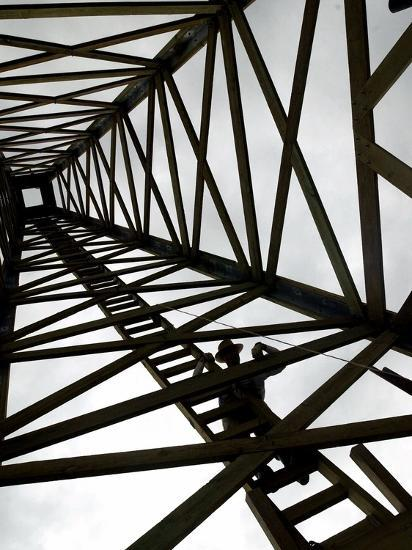 A Reenactor is Silhouetted Inside a Replica of the Spindletop Oil Derrick--Photographic Print
