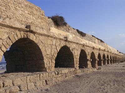 A Relatively Intact Roman Aqueduct Near the Mediterranean Sea-Nick Caloyianis-Photographic Print