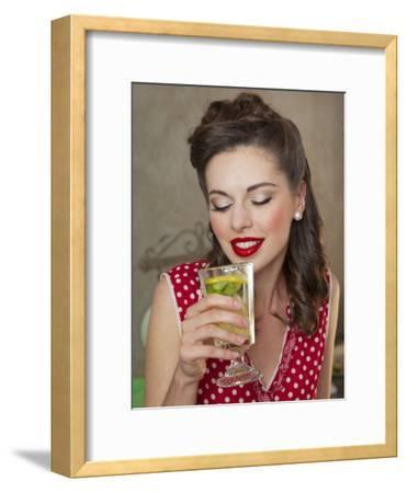 A Retro-Style Girl Drinking Lemonade