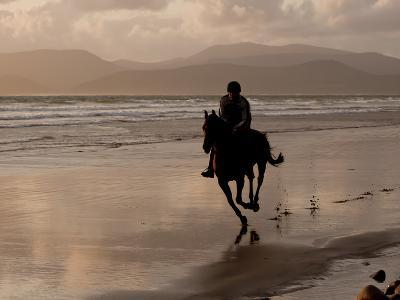 A Rider Exercises a Horse in the Evening on the Beach at Rosbehy Point-Kenneth Ginn-Photographic Print