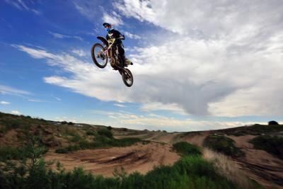 https://imgc.artprintimages.com/img/print/a-rider-jumps-high-in-the-air-at-a-motocross-event_u-l-q12wwsi0.jpg?p=0