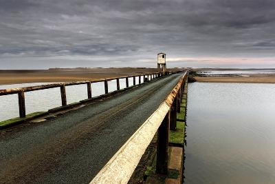 A Road Going over Water Towards a Beach; Northumberland,England-Design Pics Inc-Photographic Print