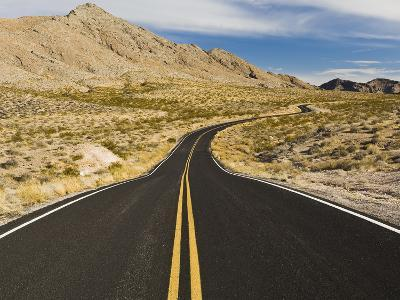 A Road Through and Arid Desert Landscape-James Forte-Photographic Print