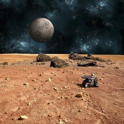 A Robotic Rover Explores an Alien World with a Cratered Moon Rising Above-Stocktrek Images-Photographic Print