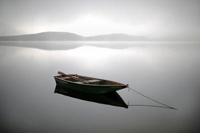 A Row Boat Floats on the Banks of Foggy Edersee Lake Near Waldeck, Central Germany-Uwe Zucchi-Photographic Print