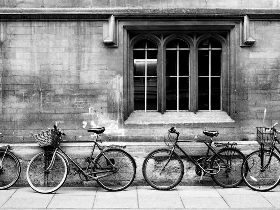A Row of Bikes Leaning Against an Old School Building in Oxford, England-Keith Barraclough-Photographic Print
